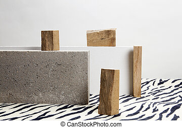 concrete blocks, raw wood and zebra carpet. - 2 concrete...