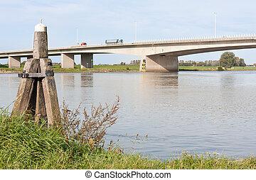Concrete bridge crossing the river IJssel, the Netherlands,...