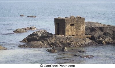 Concrete Bunker on Beach Rocks in Sri Lanka - Cubic concrete...