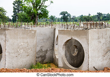Concrete drainage pipes on construction site