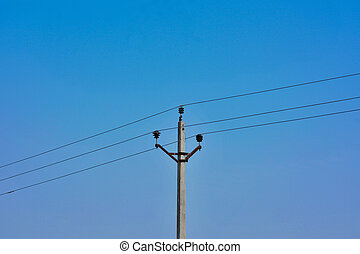 Concrete electric pole with blue sky background