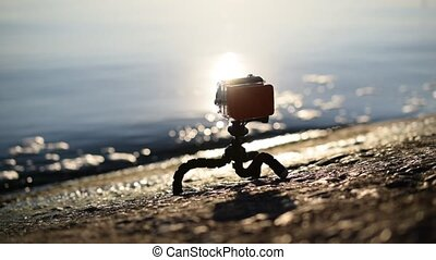 Concrete embankment with an action camera in waterproof case...