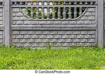 Concrete fence with decorative motifs