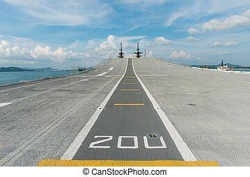 Concrete fighter jet run way of an aircraft carrier, taken...