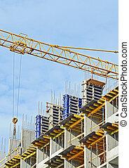 Concrete formwork and crane on construction site