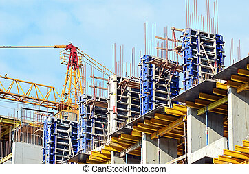 Concrete formwork with a folding mechanism and floor beams on construction site