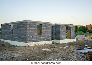 Concrete foundation of a new house, wall construction