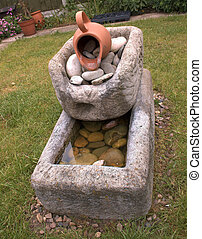 garden feature - concrete garden feature in the middle of a...