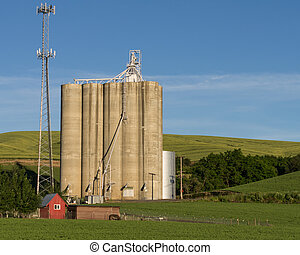 Concrete grain silos with cell phone tower