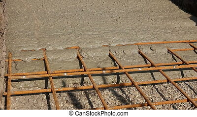 Concrete is spreading in foundation over reinforcing steel...