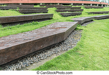 Concrete long bench in the park