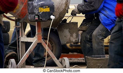 Concrete Mixer Builders and People Working at a Construction...