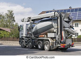 concrete mixer machine on city street - concrete mixer truck...