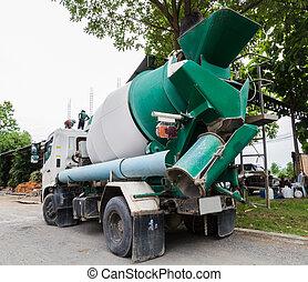 Concrete mixer truck in construction site.