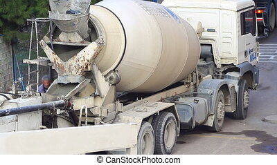 Concrete mixer trucks at work Time