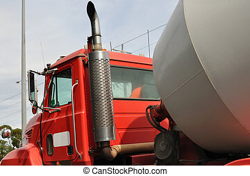 Concrete mixing truck on road close-up