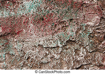 Concrete partially covered with colored paints