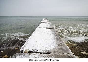 Concrete pier with ice and snow