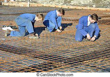 concrete pour preparation - Builders tie off sections of...