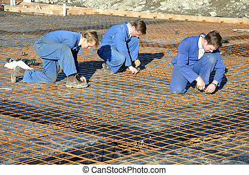 concrete pour preparation - Builders tie off sections of...
