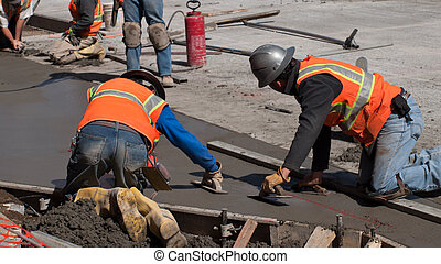 Concrete Road Construction - Road construction worker on new...