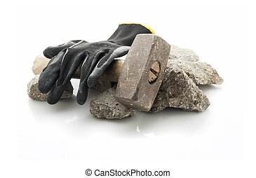 Concrete rubble debris with hammer and gloves isolated on...