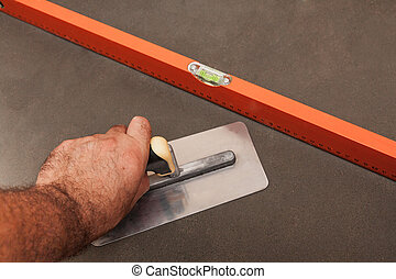 Concrete screed - Concrete leveling, worker's hand