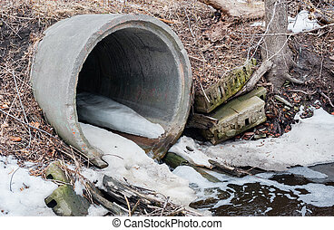 Concrete sewer culvert emptying in winter. - Large cement...