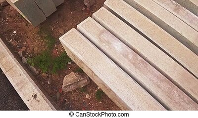 Concrete slabs in stack on ground from above view, dolly...