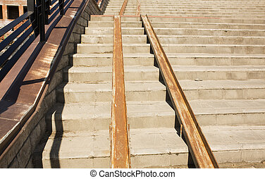 Concrete staircase with a ramp