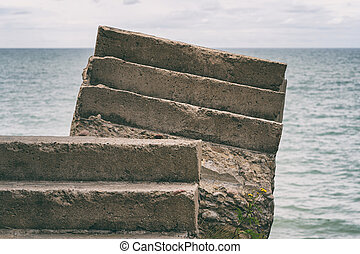 Concrete stairs steps on the background of the sea