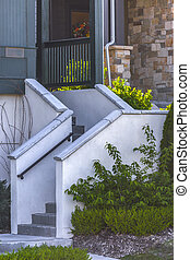 Concrete stairs to the entry of townhome in Daybreak Utah