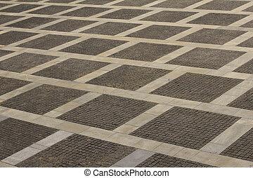 Concrete tile on the square