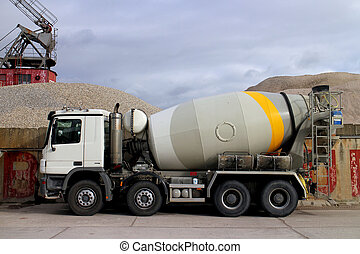 Concrete truck in front of a sand and gravel site
