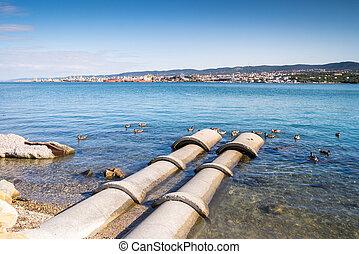 Concrete tubes going into the sea