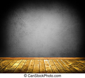 Concrete wall and wooden floor background.