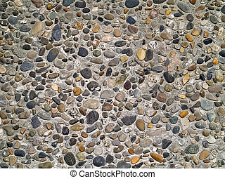 Concrete wall made of small river rocks