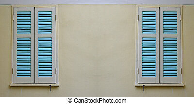 concrete wall with blue window