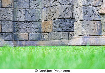 Concrete wall with grass