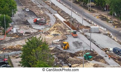 Concrete works for road construction with many workers and mixer timelapse