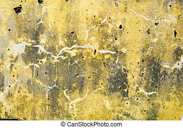 Concrete yellow and gray old dilapidated ancient flat stone wall texture with veins, divorces, patterns, cracks, pores and holes background