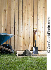 Concreting tools and wheelbarrow in DIY project