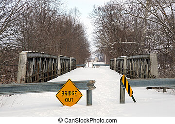 A snowy old triple pony truss bridge spanning Indian Creek on Old Indiana SR 37, south of Martinsville, has been closed to traffic.