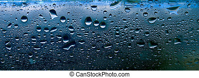 Close up of water droplets on glass.
