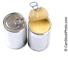 Condensed milk in tin cans over white background