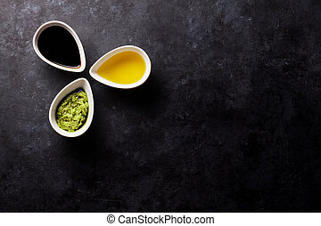 Condiments on stone background. Top view with copy space