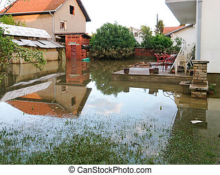 condition of house with a yard after floods, flood and ...