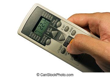 Conditioner remote control in the hand.
