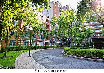 Circular driveway and sidewalk at brick condominium building