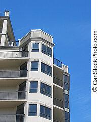 Condo building with blue sky